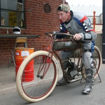 Troy Corser getting a feel for a very old racebike.