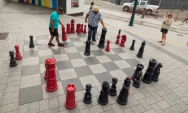 Locals playing chess in the town square. By swivelling the screen not he E-M5II I could get an overhead shot.