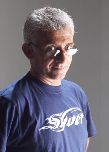 Dennis Penzo wearing a Shoei T-shirt.
